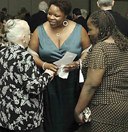 Karen Roberts, from Oakwood (left) talks with Nan-C Moss (center) and Sheri Wise, both from Dayton at the 21st birthday party of the Human Race Theatre Company in Sinclair's Ponitz Center, Saturday night, April 28th.