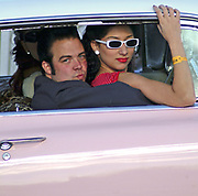 A couple of Rockabillies riding in a pink 50's style car, Viva Las Vegas Festival, Las Vegas, USA 2006.
