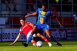 Billy Jones of Rotherham United slides in to tackle Sean Goss of Shrewsbury Town - Mandatory by-line: Ryan Crockett/JMP - 21/09/2019 - FOOTBALL - Aesseal New York Stadium - Rotherham, England - Rotherham United v Shrewsbury Town - Sky Bet League One