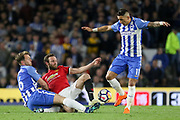 Brighton and Hove Albion midfielder Dale Stephens (6) tackles Manchester United Midfielder Juan Mata during the Premier League match between Brighton and Hove Albion and Manchester United at the American Express Community Stadium, Brighton and Hove, England on 4 May 2018. Picture by Phil Duncan.