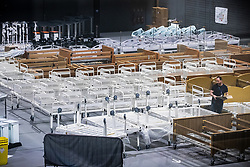 © Licensed to London News Pictures. 12/04/2020. Manchester, UK. Dozens of new beds are standing assembled in the venue canteen . The National Health Service is building a 648 bed field hospital for the treatment of Covid-19 patients , at the historical railway station terminus which now forms the main hall of the Manchester Central Convention Centre . The facility is due to open on Easter Monday , 13th April 2020 , and will treat patients from across the North West of England , providing them with general medical care and oxygen therapy after discharge from Intensive Care Units . Photo credit: Joel Goodman/LNP