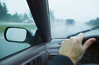 Drivers view through windshield on a highway in the rain.