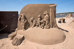 "© Licensed to London News Pictures. 12/05/2019. Weston-super-Mare, North Somerset, UK. The Weston-super-Mare Sand Sculpture Festival at Weston's beach. A sand sculpture titled ""What if Deforestation continues?"" by artist Susanne Paucker. The Weston Sand Sculpture Festival promises a new theme each year and this year the broad ""What If…?"" topic has allowed artists to create conceptual pieces of art portraying some important and alarming messages from Brexit, Climate Change to Feminism. Photo credit: Simon Chapman/LNP"