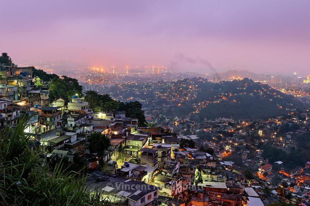 """Sunrise on the favela Morro dos Prazeres, after a """"Baile"""" Funk. Rio de Janeiro."""