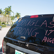 A message of support the day when students and parents came for campus orientation at the Marjory Stoneman Douglas high school for reopening following last week's mass shooting in Parkland, Florida, U.S., February 25, 2018. Attendance was voluntary but hundreds of students and parents showed up. The school opens this coming Wednesday. Seventeen persons including students and staff were murdered in the shooting. REUTERS/Angel Valentin