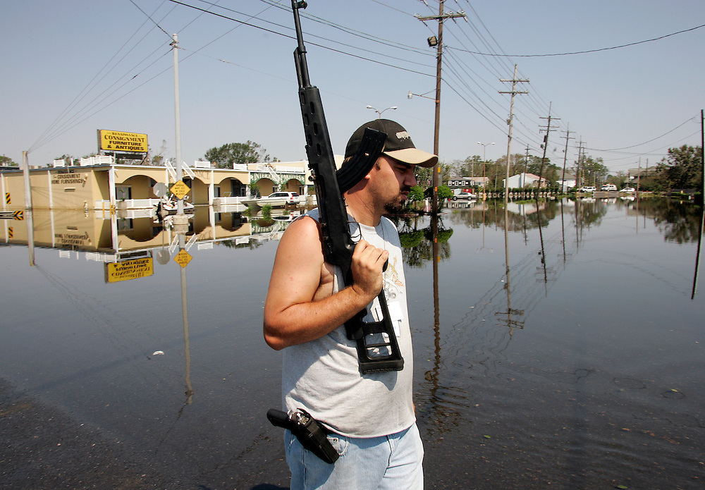 NEW ORLEANS, LA - September 4, 2005:  Heavily armed private security personnel guard firefighters searching flooded New Orleans, LA on Sept. 4, 2005 for survivors of Hurricane Katrina. (Photo by Todd Bigelow/Aurora)