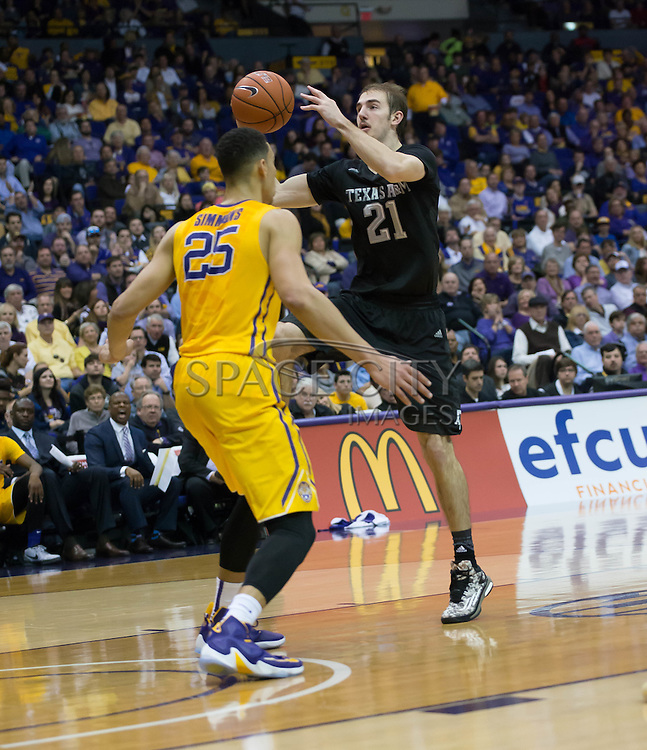 Alex Caruso(21) goes up for a layup over Ben Simmons(25) LSU. LSU defeats Texas A&M 76-71 in Baton Rouge, Louisiana. Photo BY: Jerome Hicks/ Space City Images