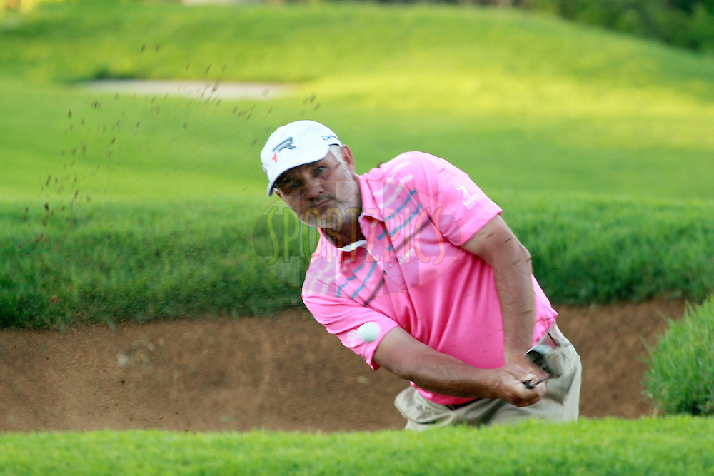 Gideon van Zyl on the 18th during the second round of the Sanlam Cancer Challenge Finals held at the Gary Player Golf Club in Sun City near Johannesburg on the 22nd October 2013. Photo by Jacques Rossouw - SPORTZPICS