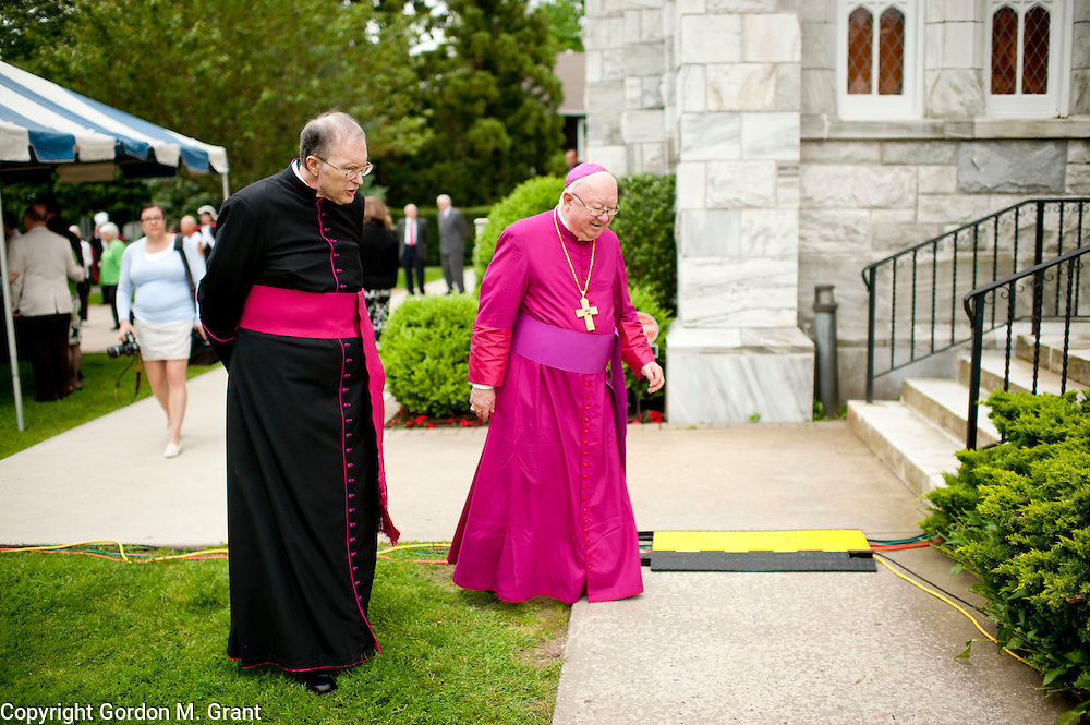 Rev. Msgr. Jeffrey Madley, left, of the Sacred Hearts of Jesus and Mary Church, walks with Bishop William Murphy, prior to a mass dedicating the church as a minor basilica, Long Island's first basilica, in Southampton. (May 27, 2012)