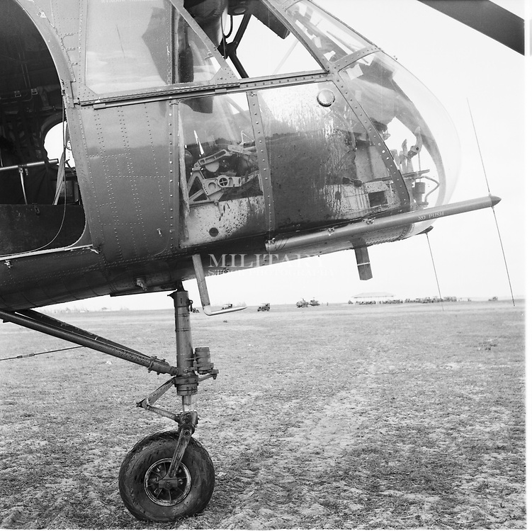 Cockpit of H-21 helicopter after dead pilot removed from right seat.  The aircraft was hit many times on approach to its landing zone about twenty miles west of Tuy Hoa, 22 Dec 62.  The pilot was struck by a bullet that came through the canopy and struck him in the head.  The fuel cell was hit about five times.  Combat operations in Viet Nam, 1962-63, 8th Transportation Company, Qui Nhon RVN.  Photograph by Hans Halberstadt.