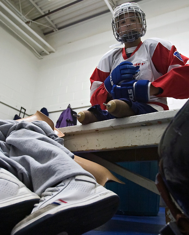 Thirteen-year-old Bubba Torres puts on his equipment in preparation for an exhibition game against the Junior Flyers at Ice Line Arena on Saturday, February 13, 2005 in West Chester, PA. Born with Ectrodactyly, he had non-functional legs for the first year and a half of his life. As they were of no use and would not grow normally with him, his parents made the difficult decision to have them amputated. (Photo by: Drew Hallowell for ESPN)