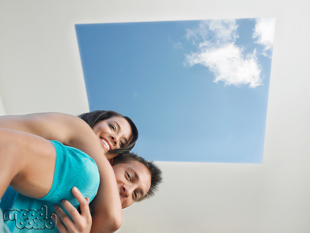 Affectionate Young Couple Under Skylight