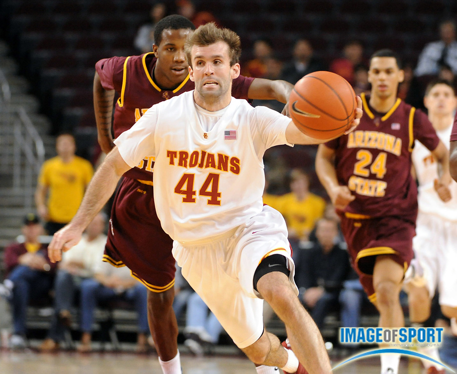 Jan 2, 2010; Los Angeles, CA, USA; Southern California Trojans guard Mike Gerrity (44) is defended by Arizona State Sun Devils forward Victor Rudd (22) at the Galen Center. USC defeated Arizona State 47-37. Mandatory Credit: Kirby Lee/Image of Sport-US PRESSWIRE
