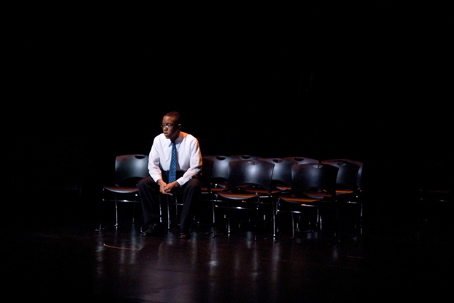 """LEST WE FORGET -- """"Dr. Baker"""" (played by Washington University in St. Louis student Patrick Easley) ponders his future after students stage a walk-out during his class as part of the Black Anthology 2012 """"Lest We Forget"""" at Edison Theatre on the Danforth Campus in St. Louis Friday, Feb. 3, 2012. Photo © copyright 2012 Washington University in St. Louis."""