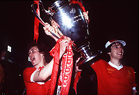 Fotball<br /> England <br /> Foto: Colorsport/Digitalsport<br /> NORWAY ONLY<br /> <br /> Phil Neal and Alan Hansen celebrate with the European Cup after victory for Liverpool. Liverpool v FC Bruges, 10/05/1978. Wembley.