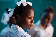 CLIENT: UNICEF<br /> <br /> Students welcome a delegation as they study in  a classroom that lost its roof and a wall in the January 12 earthquake, at the Saint Gerard School in Port-au-Prince, Haiti.