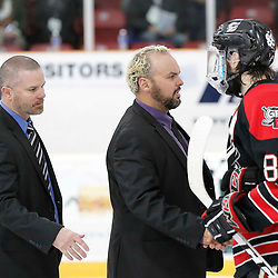 TRENTON, ON  - MAY 5,  2017: Canadian Junior Hockey League, Central Canadian Jr. &quot;A&quot; Championship. The Dudley Hewitt Cup. Game 7 between The Georgetown Raiders and The Powassan Voodoos. Powassan Voodoos Coaching Staff shake hands after the game <br /> (Photo by Amy Deroche / OJHL Images)