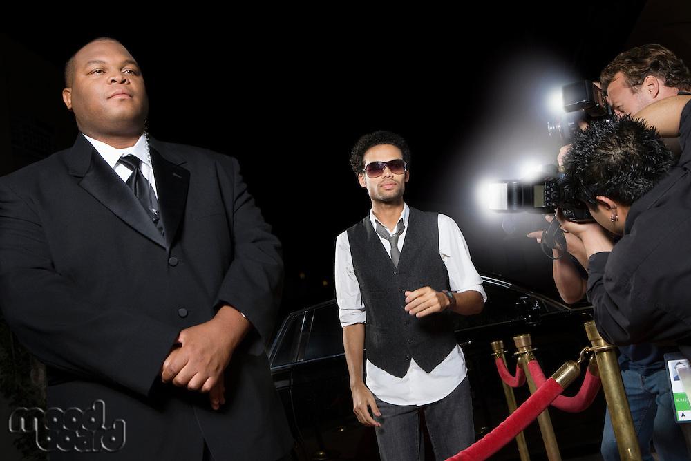 Male celebrity arriving at media event