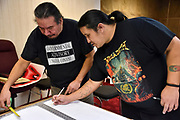 Making the banner for the Love for Tina / Justice for Colton Boushie vigil at Utah Phillips Center for the Hobo Arts in Windsor, Canada. The group decided on a banner that reads Justice Equality.
