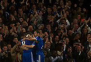 Chelsea's players celebrate after scoring against Basel during their UEFA Champions League group match at Stamford Bridge in London, 27 August 2013.  BOGDAN MARAN / BPA