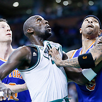 28 April 2013: Boston Celtics center Kevin Garnett (5) vies for the rebound with New York Knicks power forward Kenyon Martin (3) and New York Knicks small forward Steve Novak (16) during Boston Celtics overtime 97-90 victory over the New York Knicks during Game Four of the Eastern Conference Quarterfinals of the 2013 NBA Playoffs at the TD Garden, Boston, Massachusetts, USA.