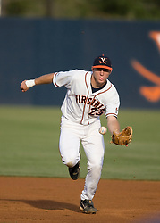 Virginia Cavaliers INF David Adams (23) fields a ground ball.  The #16 ranked Virginia Cavaliers baseball team defeated the Wake Forest Demon Decons 4-2 at the University of Virginia's Davenport Field in Charlottesville, VA on April 18, 2008.