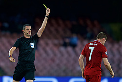 NAPLES, ITALY - Wednesday, October 3, 2018: Liverpool's captain James Milner is shown a yellow card by referee Viktor Kassai during the UEFA Champions League Group C match between S.S.C. Napoli and Liverpool FC at Stadio San Paolo. (Pic by David Rawcliffe/Propaganda)