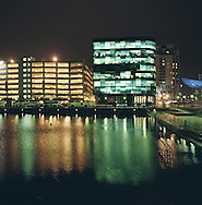 An office block illuminated at night at the Salford Quay development at the western end of the Manchester Ship Canal which links in with the river Mersey to connect with the Irish Sea. The Mersey is a river in north west England which stretches for 70 miles (112 km) from Stockport, Greater Manchester, ending at Liverpool Bay, Merseyside. For centuries, it formed part of the ancient county divide between Lancashire and Cheshire.