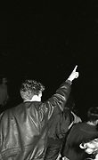 Man pointing to the sky at the first outdoor rave up North, The Gio Goi Joy Rave run by Anthony and Chris Donnelly, Ashworth Valley, Rochdale, 5th August 1989.