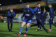AFC Wimbledon midfielder Max Sanders (23) warming up prior to kick off during the EFL Sky Bet League 1 match between AFC Wimbledon and Ipswich Town at the Cherry Red Records Stadium, Kingston, England on 11 February 2020.