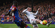 Wayne Rooney sticks a leg out to block Yannick Bolasie's effort during the Barclays Premier League match between Crystal Palace and Manchester United at Selhurst Park, London, England on 31 October 2015. Photo by Michael Hulf.