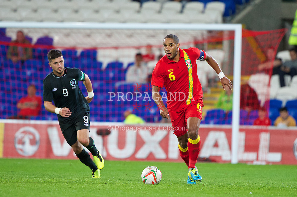 CARDIFF, WALES - Wednesday, August 14, 2013: Wales' captain Ashley Williams in action against Republic of Ireland during an International Friendly at the Cardiff City Stadium. (Pic by David Rawcliffe/Propaganda)