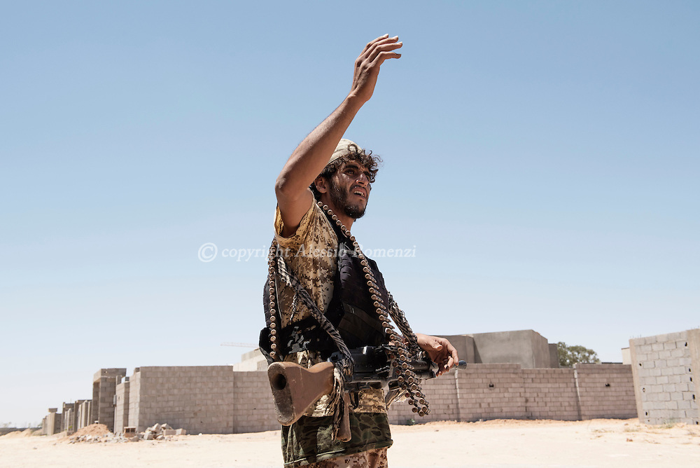 Libya: A Libya's Government of National Accord's (GNA) fighter gestures to his comrades in 700 neighbourhood in Sirte. Alessio Romenzi