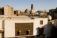 Egypt. Cairo elevated view.  - BAYT AL SIHAYMI, traditional houses in  al Gamaliyya  area. in the distance the mosque of BARSBAY al Quashangir and minaret Islamic Cairo .      NM339