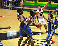 """Ole Miss' Courtney Marbra (25) vs. Kentucky's Brittany Henderson (40) and Jennifer O'Neill (0) in women's college basketball at the C.M. """"Tad"""" Smith Coliseum in Oxford, Miss. on Thursday, February 28, 2013. Kentucky won 90-65."""