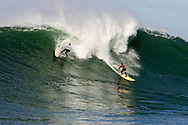Ross Clarke-Jones wipeout while Ryan Seelbach surfs out of a huge wave at Mavericks Surf Contest 2008
