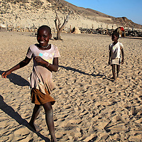 Africa, Namibia, Kunene. Young Himba girl with smile on her face.