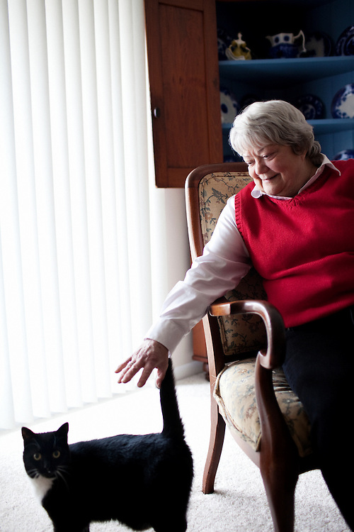 Linda Groeber, 67, strokes her cat, Socks,  in her Lutherville-Timonium, Maryland home on Wednesday, January 13, 2010. As she ages Linda has relied more on her daughters Tracey Brown and Annie Groeber to help with day-to-day tasks.