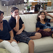 MAY 23, 2015---BOCA RATON, FLORIDA----<br /> The Zietz family sits around watching the show Shark Tank in the Boca Raton house. From left; Rachel, Jordan, 13 and Rachel. Parents Sam and Rachel have instilled in their children the entrepreneurial spirit and it has paid off. Older children Rachel, 14, and her brother Jordan, 13, each has their own business and they're thriving.