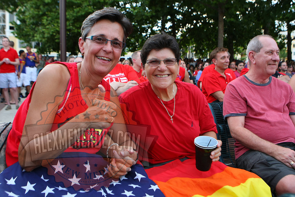 """Judy Rettig and Christine Santoro have been together for 39 years. Together the couple gathered in Lake Eola park during the """"Marriage Equality Rally"""" at the Lake Eola bandshell in downtown Orlando, Florida on Thursday, June 27, 2013. Orlando's gay community and its supporters are celebrating the U.S. Supreme Court rulings on gay marriage and the Defense of Marriage Act (DOMA) reversal that constitutionally denied legally married gay couples federal benefits. (AP Photo/Alex Menendez)"""