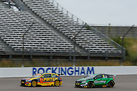 #77 Andrew Jordan BMW Pirtek Racing BMW 125i M Sport in front of #15 Tom Oliphant Ciceley Motorsport Mercedes-Benz A-Classduring BTCC Race 1 as part of the Dunlop MSA British Touring Car Championship - Rockingham 2018 at Rockingham, Corby, Northamptonshire, United Kingdom. August 12 2018. World Copyright Peter Taylor/PSP. Copy of publication required for printed pictures.