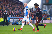 Aaron Mooy of Huddersfield Town (10) passes the ball during the Premier League match between Huddersfield Town and Arsenal at the John Smiths Stadium, Huddersfield, England on 9 February 2019.