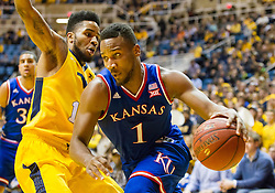 Jan 12, 2016; Morgantown, WV, USA; Kansas Jayhawks guard Wayne Selden Jr. (1) drives baseline past West Virginia Mountaineers guard Tarik Phillip (12) during the first half at the WVU Coliseum. Mandatory Credit: Ben Queen-USA TODAY Sports
