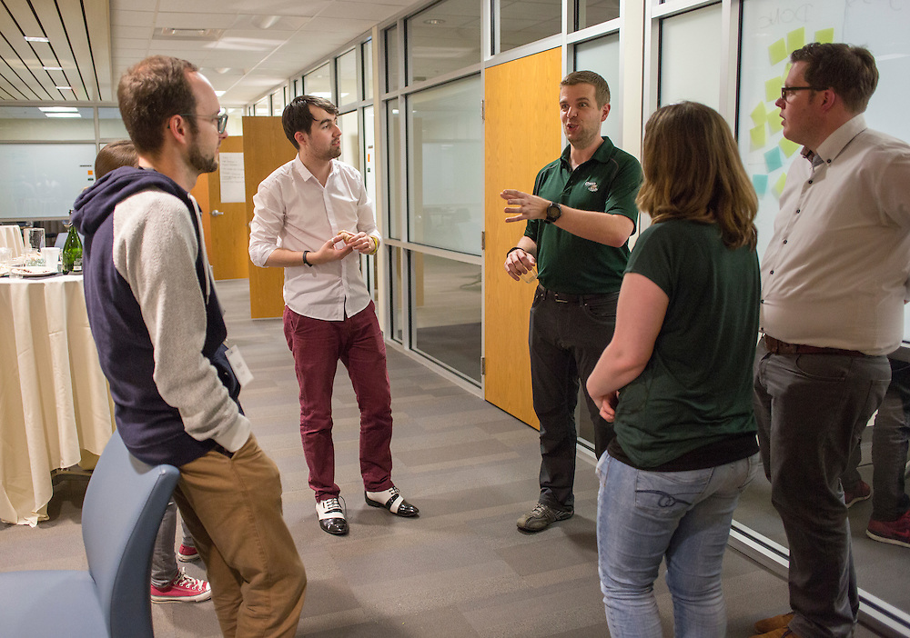 Marco Habermann, an assistant professor in the College of Business, talks with participants of the training day with Sogeti during the reception on March 10, 2016. Photo by Emily Matthews