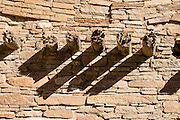 Support timbers decay in stone wall at Pueblo Bonito, Chaco Culture National Historical Park, New Mexico, USA. Pueblo Bonito is a monumental public building (Puebloan Great House) occupied from around 828 to 1126 AD, now preserved in Chaco Canyon. The huge D-shaped complex of Pueblo Bonito enclosed two plazas with dozens of ceremonial kivas, plus 600 rooms towering 4 and 5 stories above the valley floor. The functions of this building included ceremony, administration, trading, storage, hospitality, communications, astronomy, and burial, but few living quarters. Chaco Culture NHP hosts the densest and most exceptional concentration of pueblos in the American Southwest and is a UNESCO World Heritage Site, located in remote northwestern New Mexico, between Albuquerque and Farmington. From 850 AD to 1250 AD, Chaco Canyon advanced then declined as a major center of culture for the Ancient Pueblo Peoples. Chacoans quarried sandstone blocks and hauled timber from great distances, assembling fifteen major complexes that remained the largest buildings in North America until the 1800s. Climate change may have led to its abandonment, beginning with a 50-year drought starting in 1130.