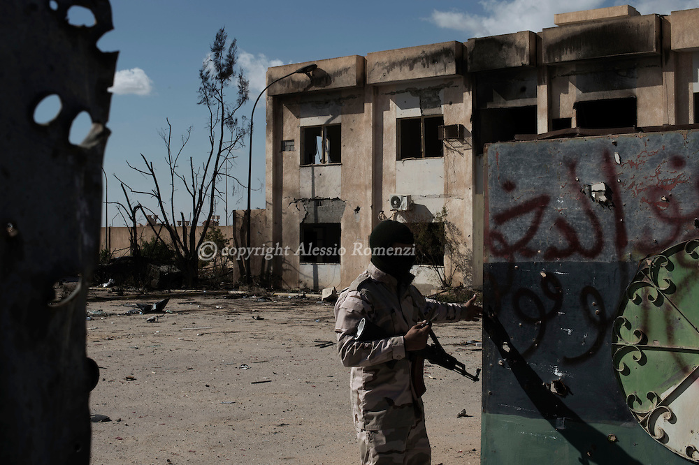 Libya, Zliten: A Misurata army soldier open the gate of the police base where a terror attack left 62 dead and almost 150 wounded. <br /> On January 7, 2016 a water tank full of explosive enter the gate of al-Jahfal training camp and exploded as recruits were training in the front yard. Alessio Romenzi