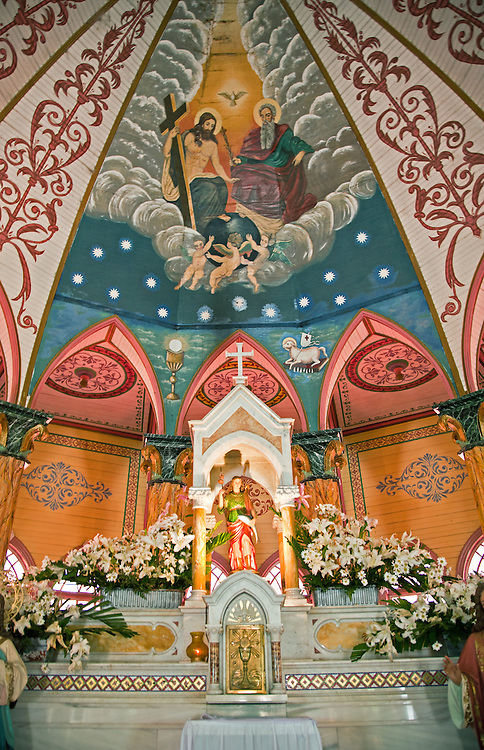 Zarcero, Alajuela, Central Highlands:  Altar area, painted vault of the Iglesia de San Rafael, known as the pink and white church.  It was built in 1895 with an exterior of metal siding and a painted interior of faux bois and marble.  It is one of the most beautiful painted churches in the world.