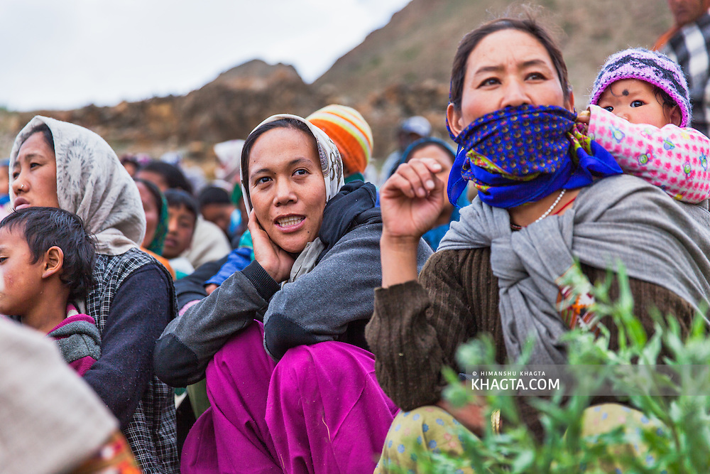 Spiti woman watching a public event in the village of Mane Yongma, Spiti, Himachal Pradesh, India