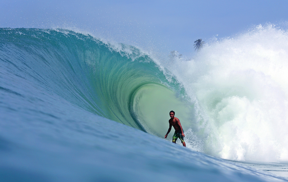Local surfer in the tube at Lagundri Bay on Nias Island.
