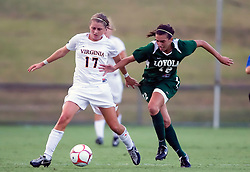 Virginia Cavaliers midfielder/forward Sinead Farrelly (17) fends off Loyola Greyhounds midfielder Lina Staropoli (12).  The #6 Virginia Cavaliers defeated the Loyola College Greyhounds 4-0 in a NCAA Women's Soccer game held at Klockner Stadium on the Grounds of the University of Virginia in Charlottesville, VA on August 22, 2008.